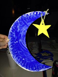 Moon & stars craft - paper plate, blue finger paint, yarn