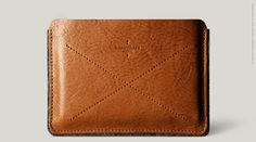 """A slim passport case that holds a couple of passports and two credit cards.  11 x 15 cm / 4.3"""" x 5.9"""" Holds 1/2 passports 10 x 13.5 cm / 3.9"""" x 5.3"""" Two dedicated credit card slots  Vegetable tan leather(hand stained) Felted wool Nappa leather Made in Italy"""
