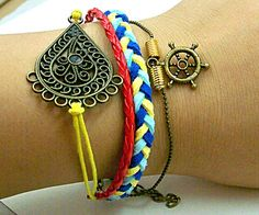 man and woman charm  leather bracelet with metal flower and   compass  red and yellow blue braid rope adjustable length