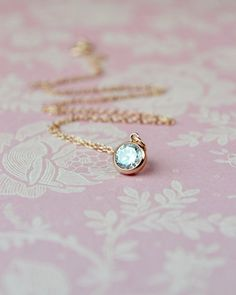This rose gold solitaire pendant with its tiny cubic zirconia charm suspended from rose gold chain is a charming and very feminine…