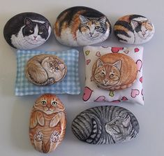 painted cats on rocks - like the positions of some.