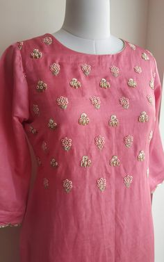 Intricate beads and zari thread handwork on front Cutwork scallop work on sleeves Shallow round neck with straight fit Embroidery On Kurtis, Hand Embroidery Dress, Kurti Embroidery Design, Embroidery Neck Designs, Embroidered Blouse, Aari Embroidery, Creative Embroidery, Silk Kurti Designs, Kurta Designs Women