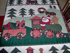 ViNtAgE Christmas QUILT... I have this quilt.  found it at a thrift shop for 2 dollars.