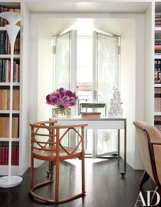 A Thonet chair by Josef Hoffmann accompanies a Rovatti table; the floor lamp is by Vibia | archdigest.com