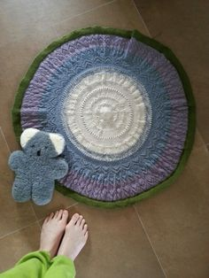 Tiny handknit peacock blanket