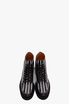 Givenchy Vegetable Tanned Leather Boots are all about the extra detailing. Check out that white stitching to complement the white stripes. Nice.