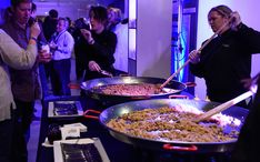 FLAMING RISOTTO STATION: Chefs cook in giant paella pans and guests choose the ingredients to put into their risotto. The picture above features lemon zest, local peas, asparagus, Parmigiano-Reggiano, and sautéed garlic shrimp.