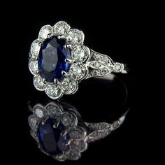 Oval sapphire with diamond cluster engagement ring
