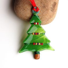 Fused Glass Ornaments | Fused Glass Christmas Tree Ornament Suncatcher by buffaloartglass Like the way it is wired with beads for decoration!