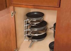 Wire Rack Pot Organizer. Great way to save space in the cupboards!