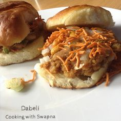 Dabeli is most popular street food in Gujarat and Mumbai. It is an Indian burger with potato filling in middle topped with onion, chu. Pulled Pork, Street Food, Spicy, Ethnic Recipes, Shredded Pork, Braised Pork