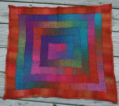 Spiral Squares blanket in 10-stitch Tunisian Crochet using Poem Sock Yarn and Trekking XXL Sock yarn for the border.
