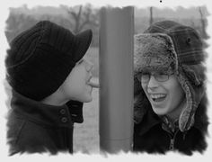 """We love the movie """"A Christmas Story"""".  So last year we decided to pay tribute to the scene the boys love best, which is where one kid dares the other kid to stick his tongue to a frozen flag pole.  I used my photo software to change the picture to black and white and frosted the edges. The caption on the card read """"WE TRIPLE DOG DARE YOU TO HAVE A MERRY CHRISTMAS"""".  Everyone loved it!"""