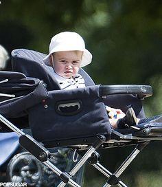 anythingandeverythingroyals:  Prince George on a walk through Kensington Gardens, July 2014