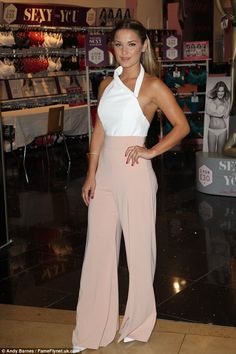 Stylish arrival: Sam Faiers opted to keep her cleavage under wraps as she launched the new range at the Bluewater shopping centre in Kent