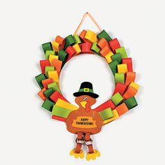 This would be so easy to make with my daughter. Love the paper chain legs. Loopy Turkey Wreath Craft Kit - OrientalTrading.com #DIY #Thanksgiving
