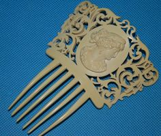 Exquisite antique 1800's Victorian celluloid cameo French ivory large size hair comb. $399.95, via Etsy.