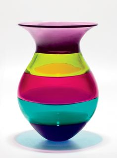 A stunning blown glass vase full of cheerful colors to brighten up a space. Color Block Vase in Jewel by Michael Trimpol and Monique LaJeunesse. Art Glass Vase available at www.artfulhome.com
