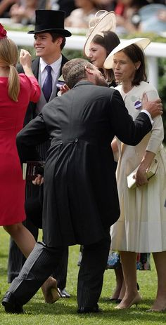 June 2018 ~ Peter Phillips struggles to kiss Lady Sarah Chatto on the Final Day of Royal Ascot as the sun continues to shine on the event in Berkshire, England. Princess Anne, Princess Margaret, Lady Sarah Armstrong Jones, Lady Sarah Chatto, Autumn Phillips, Peter Phillips, Margaret Rose, Royal Ascot, Prince Charles