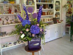 Corporate event arrangement with purple flowers by Atelier Floristic Aleksandra concept Alexandra Crisan