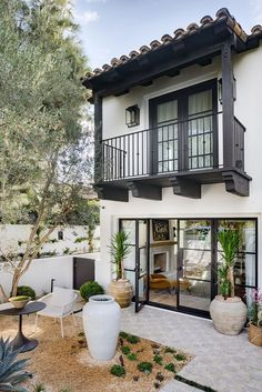 From a poorly-built spec house to a fully custom family home, Shannon McLaren Wilkins delivers West Coast bliss for a family of four. From a poorly-built spec house to a fully custom family home, Shannon McLaren Wilkins delivers West Coast bliss. House Design, House, Outdoor Living, House Exterior, House Styles, Exterior Design, Mediterranean Homes, Spanish Style Homes, Exterior