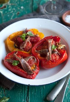 Roasted red peppers stuffed with tomatoes and served with anchovies and fresh basil