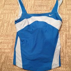 NIKE WORKOUT TOP Blue Nike workout top with built in bra and small pocket for iPod. Gently worn but Perfect condition-no rips/stains. Stretchy spandex material.  SMOKE FREE HOME FAST SHIPPING Nike Tops Tank Tops