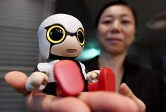 "KIROBO mini (キロボミニ) || photo: TOSHIFUMI KITAMURA/AFP/Getty Images || a new ""toy"" robot made by Toyota that is supposed to help lonely people feel happy. It responds to commands & speaks. It costs $400 