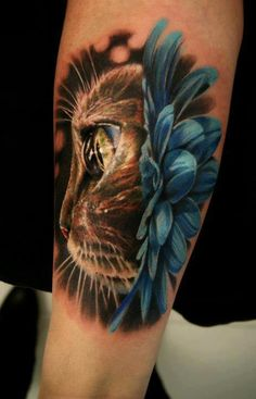 photo-realistic cat/flower tattoo