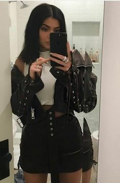 Kylie shows off in a leather outfit: Magda Butrym black jacket and skirt.