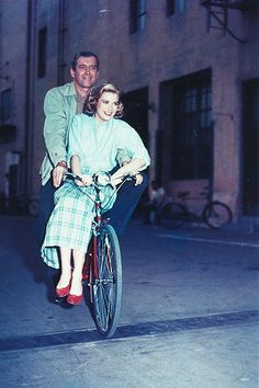 James Stewart and Grace Kelly, cycling through the studio lot during the filming of Rear Window (1954)