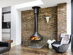 The wall version of the Ergofocus, this classy and space-saving design beat international competitors to gain a contract in Japan for installation in 301 apartments in a luxury residential building. House, Home Fireplace, Focus Fireplaces, Freestanding Fireplace, London House, Indoor Fireplace, Open Space Living, Sunroom Designs, Home Interior Design