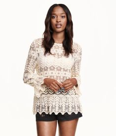 White, lace blouse with an embroidered pattern. Opening at back of neck & long sleeves with ruffle at cuffs. | H&M Divided