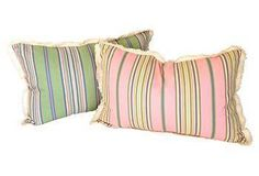 these cotton pillows have pink stripes on one side, and pistachio on the other for extra versatility.