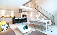 kitchen living dining Exquisite House in London With Double Volume Space by LLI Design