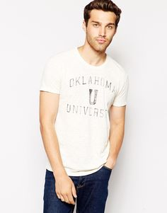 "T-shirt by United Colors of Benetton 100% Cotton Breathable, slub jersey fabric Crew neck Print to front Regular fit - true to size Our model wears a size Medium and is 185.5cm/6'1"" tall Machine wash"