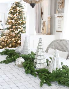 14 Festive Holiday Centerpieces That Will Make Your Table Pure Magic - These metallic trees make for the perfect centerpiece! This is a look that you can rock all month long. Simply add some fresh branches before your guests arrive.