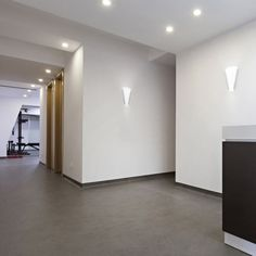 LED wall light designed in an almost triangular shape with a satin nickel steel base and opal glass to project the light uniformly. Led Wall Lamp, Led Wall Lights, Ceiling Lamp, Interior Lighting, Lighting Design, Pub Interior, Flush Lighting, Luz Led, Glass Diffuser