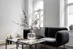 White walls and walnut floors - via Coco Lapine Design