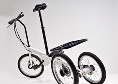 with a unique suspension and steering system, the electronically assisted tricycle is able to tilt left and right, giving it the feeling of a two wheeler.