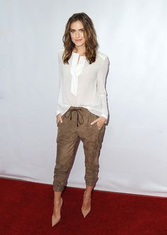Allison Williams. Silky blouse, drawstring trousers and pointed toe pumps
