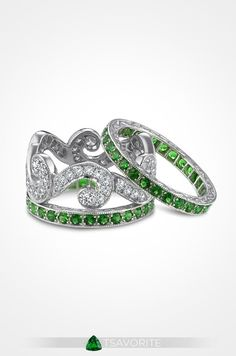 Also known as a green garnet, tsavorite is one of the more rare garnets as it needs unique conditions to form.  This platinum Fusaro Jewelry wedding ring features a gorgeous diamond swirl pattern with tsavorite guards.