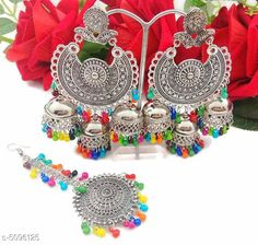 Jewellery Set Arya Stylish Women's Earrings and Maang Tikka  Base Metal: Alloy Plating: Silver Plated Stone Type: Artificial Stones Sizing: Non-Adjustable Type: 1 Pair of Jhumkas and Maang Tikka  Multipack: 1 Country of Origin: India Sizes Available: Free Size   Catalog Rating: ★4 (553)  Catalog Name: Arya Stylish Women's Earrings and Maang Tikka CatalogID_751135 C77-SC1093 Code: 022-5096125-774