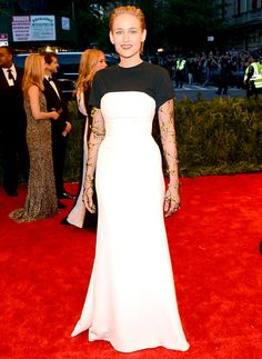 Leelee Sobieski in Dior Haute Couture white silk bustier dress with a silk and cotton t-shirt and black silk embroidered gloves at the 2013 Met Gala