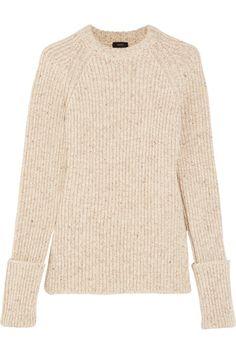 Ecru wool-blend Slips on 80% wool, 20% polyamide Hand wash or dry clean Made in…