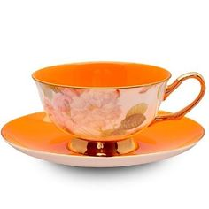 Orange teacup with Floral Motif. Bone China cup and saucer is Lead Free with a Solid Glaze. Classic Chintz design around the Cup with solid orange saucer. China Cups And Saucers, Teapots And Cups, Cup And Saucer Set, Tea Cup Saucer, Orange Tea Cups, Bone China Tea Cups, My Cup Of Tea, High Tea, Color Splash