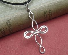 Celtic Cross Sterling Silver Pendant  by nicholasandfelice on Etsy, $18.00 - pretty! I apparently have a thing for wire jewelry right now. My mom would love something like this.