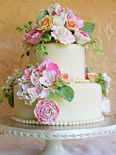 """Sedona Cake Couture ~ Soft pastel summer flowers in sugarpaste adorn this simple fondant cake dressed with white chocolate """"pearls"""" ..."""