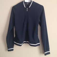 Nike lightweight jacket Nike lightweight jacket in new condition. Not sure if my daughter ever wore it even once.Navy with White stripe. Maxine washable. Bundle to save on shipping and get discount. Nike Jackets & Coats