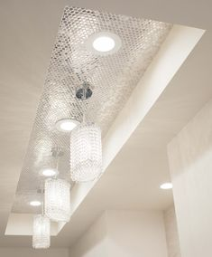For an unexpected hallway feature try a recessed ceiling tiled with a eye-catching mosaic.